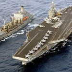 USS Harry S. Truman (CVN 75) comes alongside the Military Sealift Command Oiler USNS John Lenthall in Med 2003