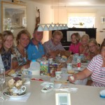 "Sunday dinner aboard ""Glissando"" last July. Marilene in pink next to dad, Lenie far right."