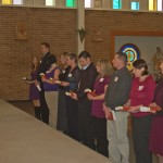 The 3rd Advent Candle, Fr. Bailey and 11 new candidates