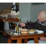 Geoffrey Lee the Melbourne ex-pat feeding himself and the sparrow their  daily lunch at Anita's Bar in San Carlos