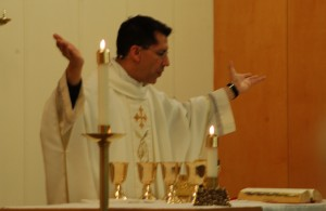 Father Mark Guzman at the Holy Thursday service.