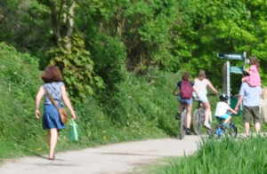 caption of left upper corner of L.R.: Anna, Lucas on bike, Anna on Andy's shoulders